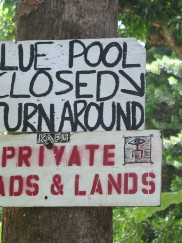 Blue pool closed signs